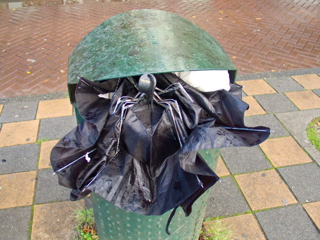 Black fold Brolly in green Bin.